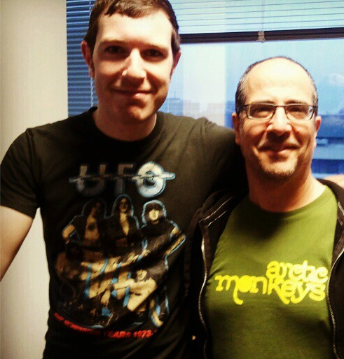 David and Daveed wearing band t-shirts